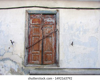 Very old window shutters closed. stock photo