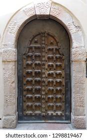 Very old wooden closing door