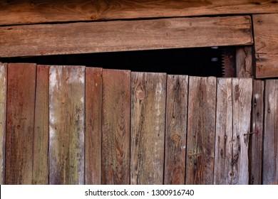 very old wooden door with a bad lock