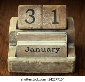 A very old wooden vintage calendar showing the date 31st January on wood background