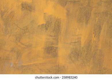Very old yellow wall with paint grunge background