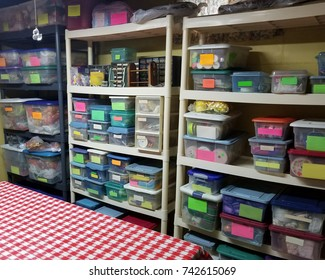 A very organized craft room with lots of containers.