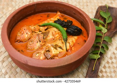 Very popular Kerala fish curry in coastal area south Indian and Sri Lanka, Malaysia, Thailand, Singapore. made by marinated mackerel fish with Indian spices. sea food in clay / mud pot