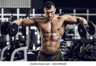 very power guy - bodybuilder, execute exercise with weight, inside gym, horizontal photo