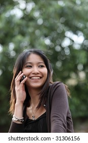 Very pretty young woman calling on her cellphone