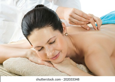 the very  pretty  young woman on acupuncture treatment , horizontal  portrait
