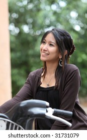 Very pretty young woman on a bicycle