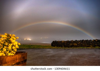 Very rare moonbow during the night above Staffin bay - Isle of Skye, Scotland.