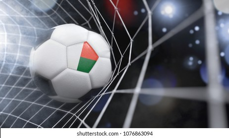 Very realistic rendering of a soccer ball with the flag of Madagascar in the net.(3D rendering)