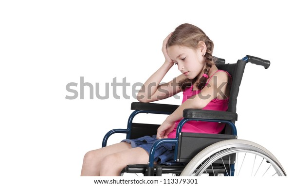 Very sad handicapped girl in a wheelchair