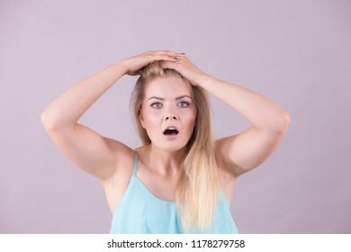 Very scared bad suprised woman seeing something disgusting or unpleasant. Shocked terrified female.