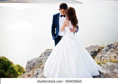Very sensual and gorgeous wedding couple on the picturesque landscapes