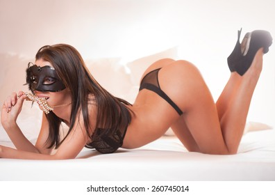 Very sexy brunette posing in stylish black lingerie.