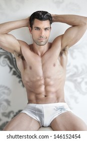 Very sexy young male muscular model in white underwear