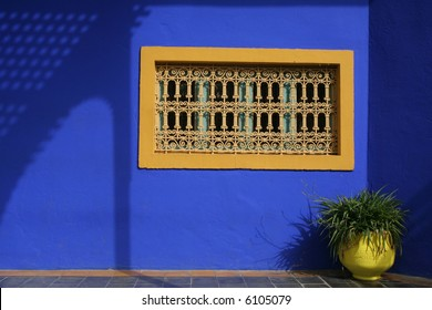 Very simple, clear image of decorated window on blue background