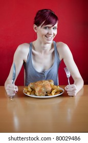Very slim young woman is happy because she'll eat a whole chicken. Selective focus.