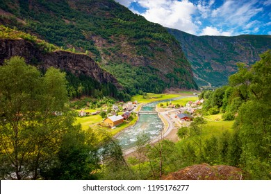 Very small village on the shore of a river in Norway