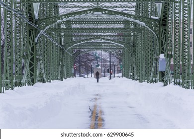 A very snowy view of the historic and restored South Washington Street Bridge in Binghamton, New York. The Lenticular through truss carries a bicycle and walking path over the Susquehanna River.