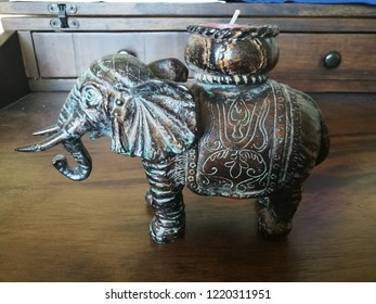A very special valuable candle holder made from brass with hand drawing artistic line as carved brown blue aventurine elephant figurine