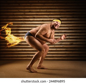 Very strange naked man farts by fire