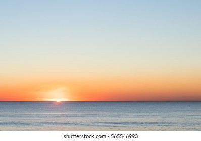 Very strong colored sunset over the calm atlantic ocean