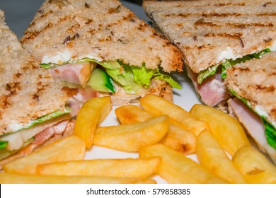 Very tasty Chicken Club sandwiches on a plate are isolated on a white background