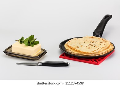very tasty pancakes on a hot frying pan with chilled butter
