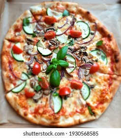 Very tasty pizza with basil leaves