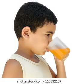 A very thirsty latin boy drinking a cold fruit juice isolated on white