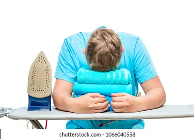 a very tired man fell asleep while ironing towels, a portrait is isolated