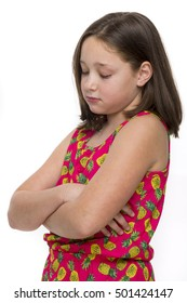 A very unhappy tween girl with folded arms