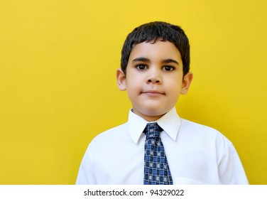 Very young business man with an optimistic expression