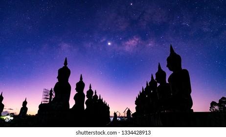 Vesak day concept,big buddha with milky way sky background.