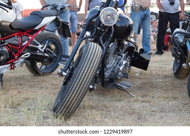 Veselovka, Krasnodar Territory / Russia-03/08/2018: The front of the motorcycle in the parking lot, in the background the motorcycle drivers and people