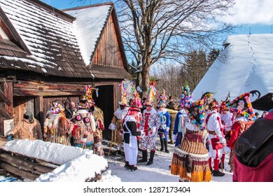 Vesely Kopec, Hlinsko, Czech Republic - January 31 2015: Shrovetide processions in open air museum, men disguised in colorful costumes and masks, sunny day, blue sky