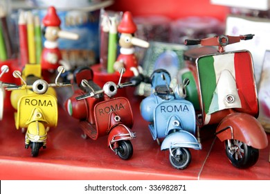 Vespa, scooter. Close-up of miniatures hand made toys motorcycles. Italian symbols.