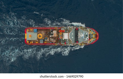 Vessel Alongside Offshore Jack Up Drilling Rig Over The Production Platform in The Middle of The Sea