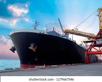 Vessel alongside at thailand port and loading bulk cargo.