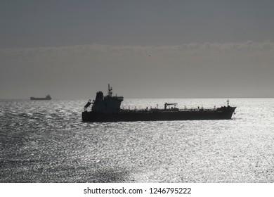 vessel close the coastline in backlight