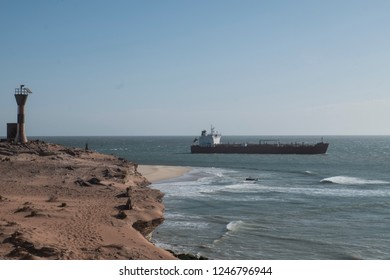 vessel Close to coastline with lighthouse in front