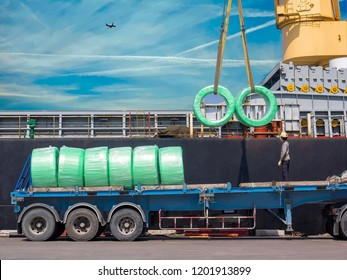 The vessel discharging steel wire rods on truck at industrial port of thailand.