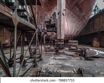 Vessel in the dock. Shipyard inside.