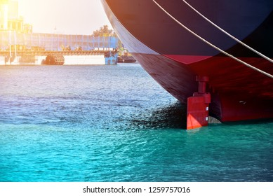 Vessel moored and stern ship with rudder ship alongside in the sea in shipyard