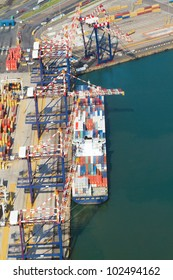 vessel offloading containers at durban harbour, south africa