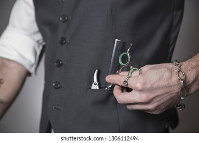 the vest pocket of a barber with the tools of his work inside