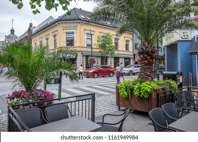 Vest-Agder, Norway -august 08, 2018: View of buildings and shopping centers on a main street in the city of Kristiansand, from an outdoor restaurant terrace