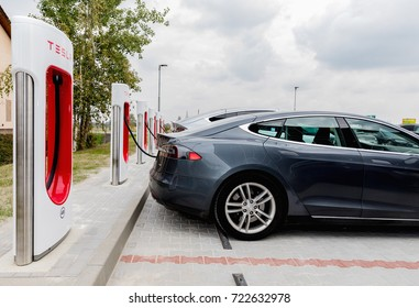 VESTEC, CZECH REPUBLIC - SEPTEMBER 23, 2017. Supercharger Tesla station. Supercharger charging station for electromobiles. Tesla cars park at the Tesla Supercharger.