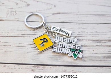 Vestfold, Norway - September, 27, 2019: Keyring GTA 5 on wooden background. Grand Theft Auto (GTA) is a series of computer games and video games.
