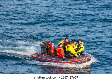 Vestmannaeyjar Iceland - August 9. 2019: people sailing the sea on a zodiac inflatable boat