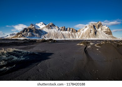 Vestrahorn in late afternoon light, covered in snow with black